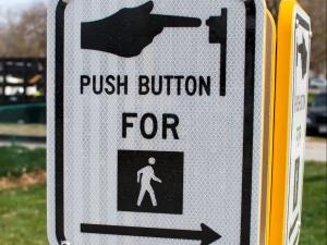 Pedestrian signal push button street crossing