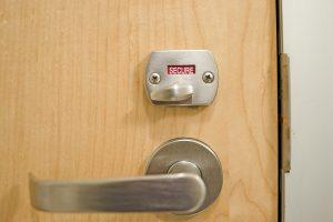 """Restroom door lock showing """"secure"""""""