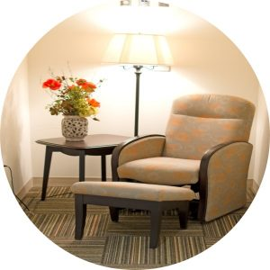 Brown chair and footstool in a lactation room
